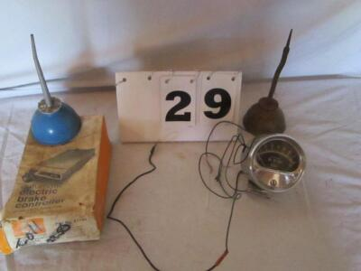 Lot of 2 oil cans, electric brake controller and an RPM gauge