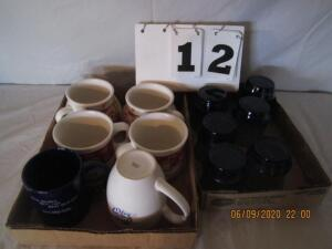 Lot of 2 flats of blue glassware and Campbell's soup mugs and other coffee mugs